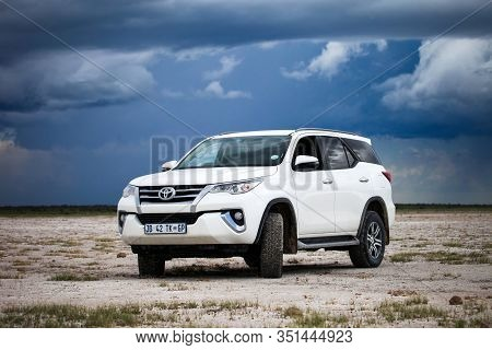 Etosha National Park, Namibia - February 6, 2020: Offroad Car Toyota Fortuner In A Savanna.