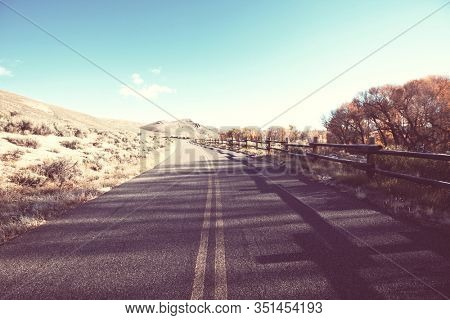 Scenic road in the mountains. Travel background. Man going on sunrise background.
