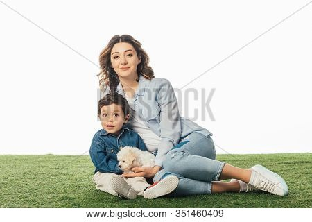 Smiling Mother And Son With Havanese Puppy Isolated On White