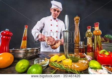Catering Business. Chef In White Uniform Planning To Cook A Beef Tomahawk Steak. Appetizing Cooking