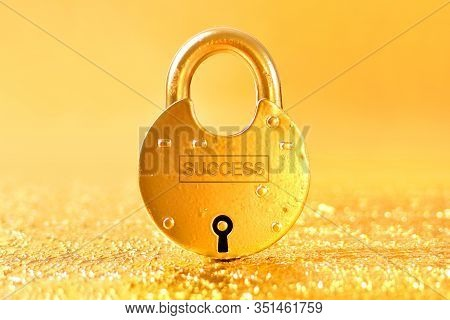 Word Success Written On The Golden Padlock With Gold Background. Way To Wealth And Success Idea.
