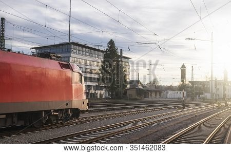 Modern Red Locomotive Traveling On Railway Tracks. Public Transport. Train Travel Concept. High-spee
