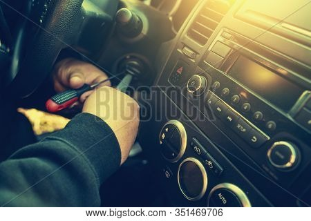 Criminal Breaks The Car Ignition Lock To Steal Auto, Close Up. Car Theft Concept, Toned