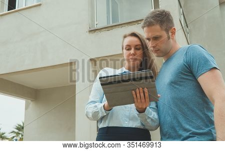 Real Estate Agent Shows The Development To His Client.