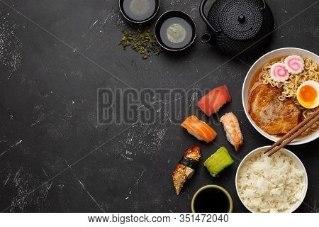 Set Of Traditional Japanese Food And Drinks: Soup Ramen, Boiled Rice, Sushi, Rolls And Green Tea In