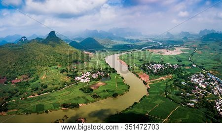 Rural Chinese Landscape Of Limestone Rocks And Rice Fields In Guangxi China Aerial View
