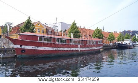 Copenhagen, Denmark - Jul 06th, 2015: Red Floating House On City Canal. Wodden House Boat Moored In