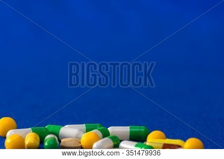 Medical Pills. Color Capsules Medication. Blue Background. Health Care Concept. Free Space For Text.
