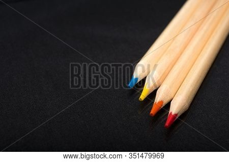 Multi-colored Wooden Pencils. Dark Black Background. Natural Materials. Stationery. Office Tools. Ba