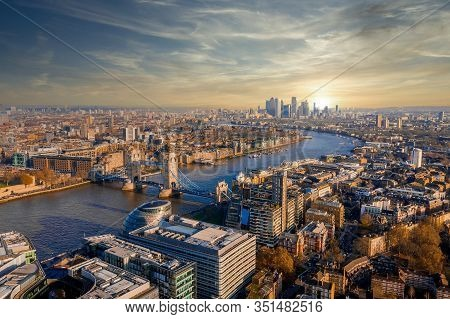 Aerial View Of The Tower Bridge In London, The Uk. Sunset Over London With Beautiful Clouds. Drawbri
