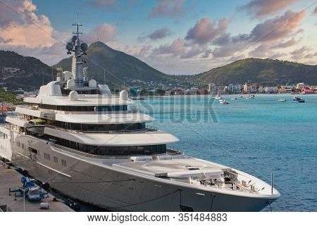 A Huge Private Luxury Yacht At A Pier In St. Martin