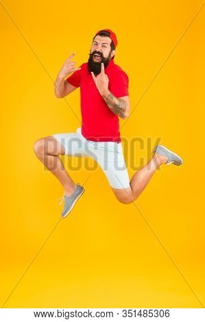 Excited Bearded Man Jumping. Full Of Energy. Impetuous Movement. Dedicated To Sport And Fitness. Act