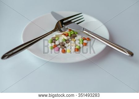 Pills On A White Plate. The Knife And Fork Gesture Did Not Like The Dish, On A Plate With Pills. Med