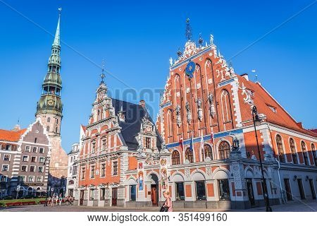 Riga, Latvia - June 25, 2016: Church Of St Peter And So Called House Of Blackheads Building On The O