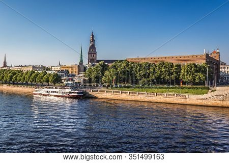 Riga, Latvia - June 25, 2016: Bank Of Daugava River I Riga City, View With Tower Of Riga Cathedral A