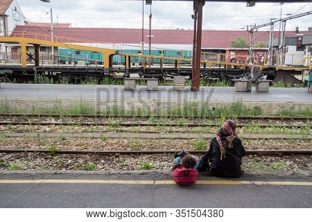 Belgrade, Serbia - July 14, 2015: Two Refugees, A Woman, Mother, And Her Daughter, Waiting For A Tra