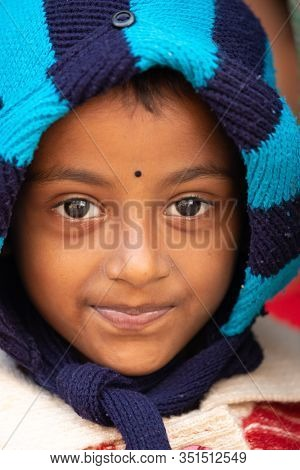 RAGHURAJPUR, INDIA, JANUARY 14, 2019 : Close portrait of a serious Indian little girl .