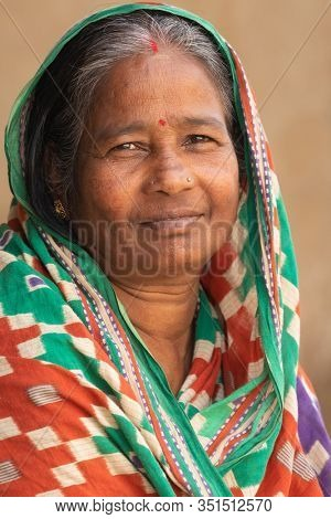 RAGHURAJPUR, INDIA, JANUARY 14, 2019 : Close portrait of a cheerful Indian woman