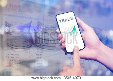 Businessman Checking Stock Market Data. He Using A Mobile Phone.trading On Stock Market With Smartph