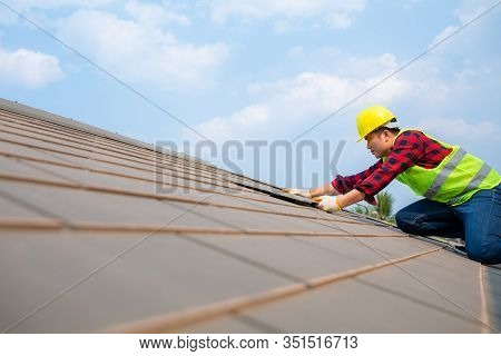 Construction Worker Install Roof Repair, Fixing Roof Tiles On House With Blue Sky In Safety Kits For