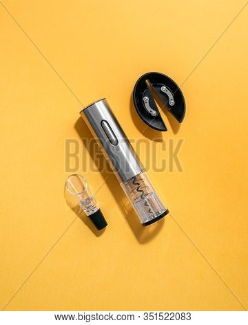 Electric Gray Metal Corkscrew, Wine Aerator And Corkscrew Stand. Yellow Background .. Top View. Isol