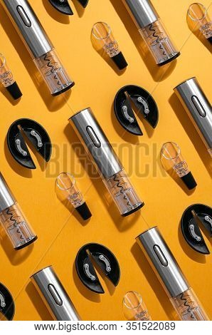 Electric Gray Metal Corkscrew, Wine Aerator And Corkscrew Stand. Yellow Background .. Top View. Patt