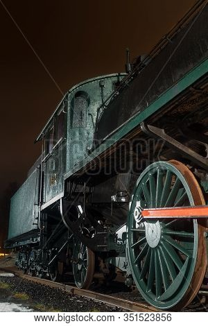 The Big Wheels Of An Old Steam Engine Are A Pretty Impressive Sight. The Beauty Of The Technology Of