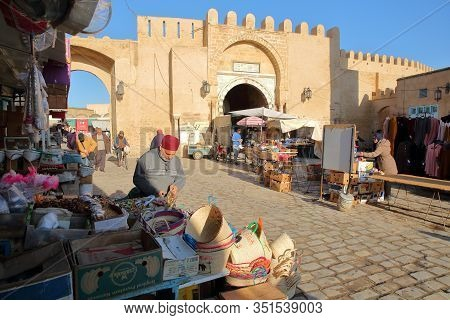 Kairouan, Tunisia - December 11, 2019: The Lively Main Street Inside The Medina Of Kairouan, With Sh