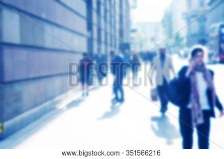 blurred people walking o the street