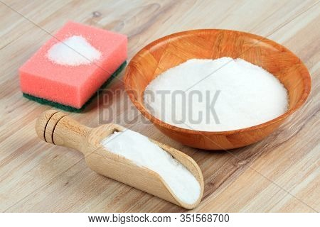 Baking Soda (sodium Bicarbonate). Soda In A Spoon And A Bowl On Wooden Table