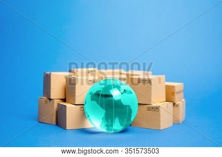 Earth Globe Is Surrounded By Boxes. Global Business And International Transportation Of Goods Produc