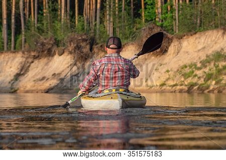 Ryazan, Russia - 06.08.2019: Back View Man With Tatoo Kayaking On River