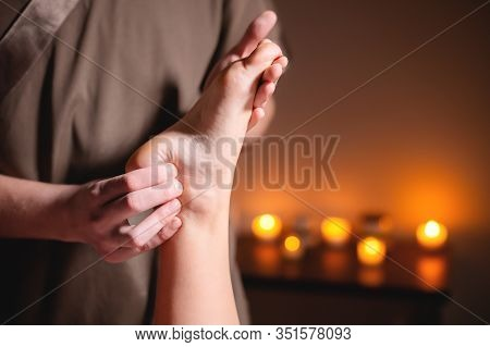 Close-up Reflexology Foot Massage. Male Masseur Makes Foot Massage To A Female Client. Foot Care Con