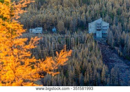 An Abandoned Unfinished Hotel In A Mountain Place In Yakutia Stands In The Forest On A Hill Among Th