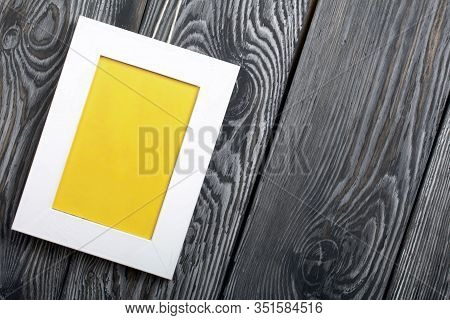 Photo Frames Of White Color With A Yellow Field. It Is Located On The Background Of Brushed Pine Boa