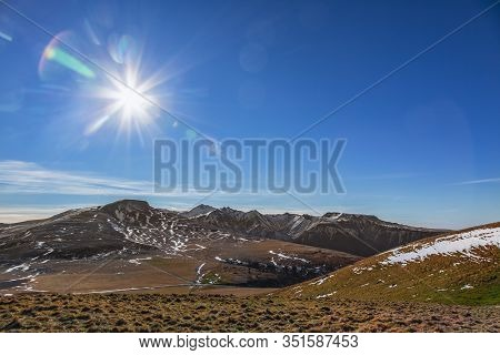 Winter Montainous Landscape In The Central Massif In France. In The Distance Is Seen Puy De Sancy