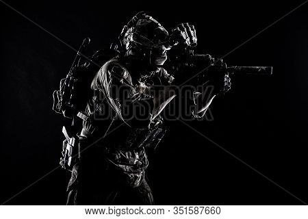 Army Special Operations Soldier, Commando Fighter In Full Tactical Ammunition, Helmet With Radio Hea