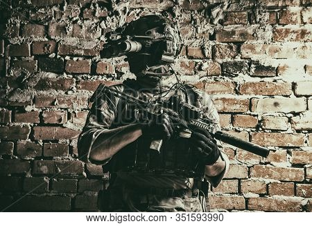 Army Special Forces Tactical Group Fighter In Cqb Mission, Using Radio Headset, Looking Through Four