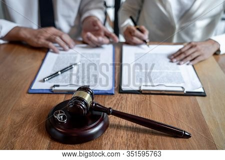 Judge Gavel And Two Golden Marriage Ring, Contract Decree Of Divorce (dissolution Or Cancellation) O