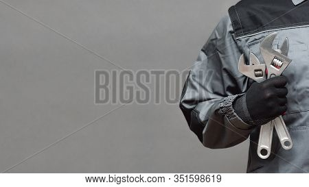 Plumber Or Car Mechanic Business Card Template. Worker Holding In Hands Adjustable Wrench Close Up O