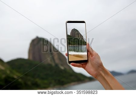 Photographing A Sugar Loaf Mountain On A Smartphone.