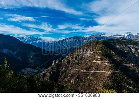 The Beautiful View Of The French Alps Mountain Range And A Road With High Contrast: Different Types