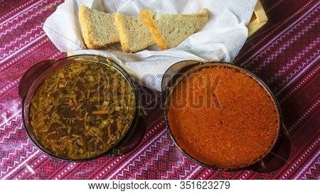 Two Plates With Ukrainian Borsch And Hodgepodge. Top View.