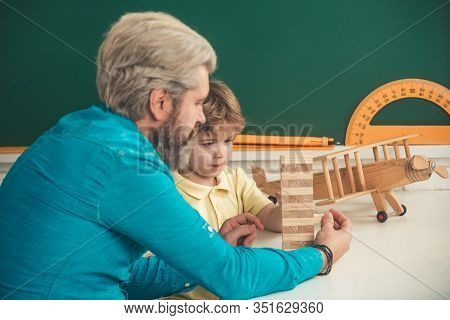 Educational Kids Games. Afterschool Tutoring. Kid And Teacher Is Learning In Class On Background Of