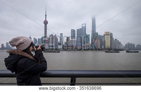 Shanghai, China - January 09 2020: The Unspecific Girl Taking Photo At The Shanghai Waitan