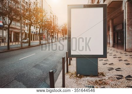 Mock-up Of An Empty Information Poster On The Pavement; A Blank Street Banner Template On A Sidewalk
