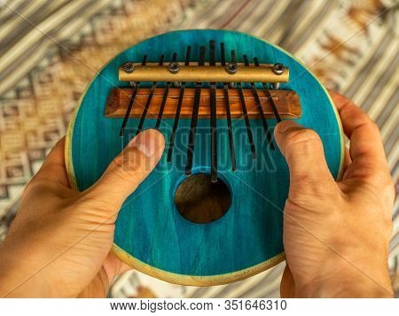 Close-up View Of A Young Man's Hands Touching The Kalimba. Traditional African Instrument. Tradition