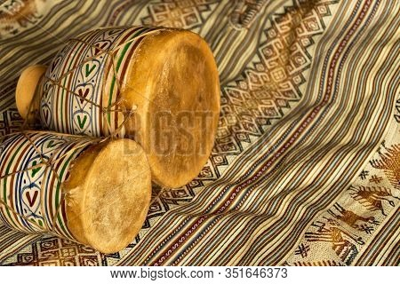 Horizontal View Of Moroccan Handmade Bongos Made Of Ceramic And Leather On A Coloured Textile. Natur