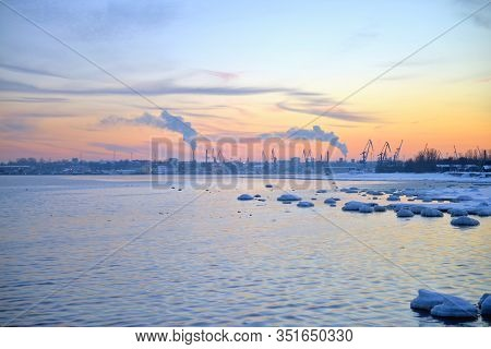 Winter Pink Sunset And Urban Landscape View On A Baltic Sea Side. Sunset With Snowy Boulders And Bea