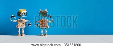 Steampunk Mechanical Robot Is Looking At A Robotic Girlfriend. Two Mechanical Toys Made Of Metal Spr